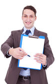 Business man showing blank clipboard — Stock Photo