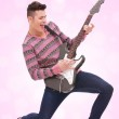 Casual young man playing a guitar — Stock Photo