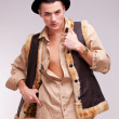 Stock Photo: Man with hat and funny fur coat posing