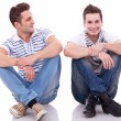Stok fotoğraf: Two casual men sitting on a white background
