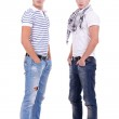 Two friends standing with their hands in pockets — Stock Photo