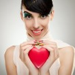 Young woman holding a heart — Stock Photo #9445481