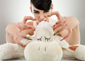 Woman killing her teddy bear — Stock Photo