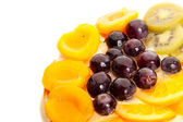 Good looking fruits on top of a yummy cake — Stock Photo