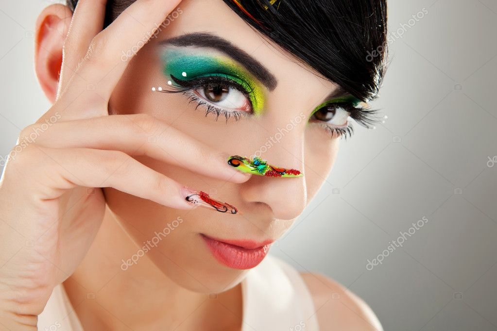 Fashion style. Woman face with so sexy  color makeup and finger nails — Stock Photo #9445449