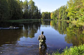 Fishing in a river — Stock Photo