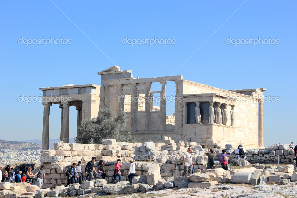 ATHENS,GREECE - April 1st: Tourists visit the Acropolis - Parthenon temple,most popular landmark in the world on April 1st 2012 in Athens,Greece — Stock Photo #10236649