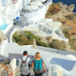 Couple visiting the island of Santorini - Stock Photo