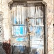 Royalty-Free Stock Photo: A very worn and battered old blue door