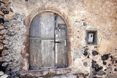 A very worn and battered old blue door — Stock Photo