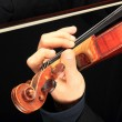 Violin is in the hands of professional violinist. - Stock Photo