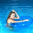 Attractive girl in the pool — Stock Photo #8202127