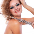 Portrait of a woman playing flute — Stok fotoğraf