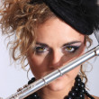 Fashion womwith transverse flute — Stock Photo #8202796
