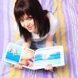 Royalty-Free Stock Photo: Beautiful young woman reading