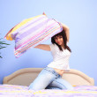 Woman having pillow fight — Stock Photo #8203049