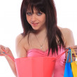Trendy young girl with a shopping bag - Stock Photo