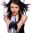 Woman with fashion hairstyle holding hairdryer — Stock Photo #8203282