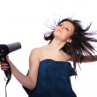 Woman with fashion hairstyle holding hairdryer — Stock Photo #8203289