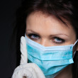 Young nurse in mask — Stock Photo #8203291