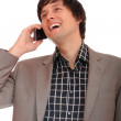 Young business man on the phone - Stock Photo