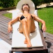 Relaxing by a swimming pool — Stock Photo #8204758