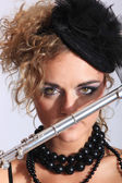 Fashion woman with transverse flute — Stock Photo
