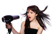 Woman with fashion hairstyle holding hairdryer — Stock Photo
