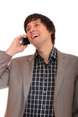 Joven empresario en el teléfono — Foto de Stock