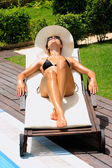 Relaxing by a swimming pool — Stock Photo