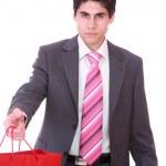 młody człowiek z torby na zakupy — Zdjęcie stockowe