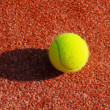 Clay court with tennis balls - Stock Photo