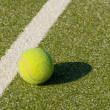 Grass court with tennis balls — Stock Photo