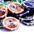 Stock Photo: Casino chips on white