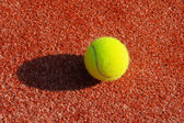 Clay court with tennis balls — Stock Photo