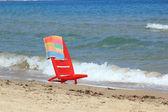An empty chair on a beach — Stock Photo