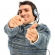 Young man listening to music — Stock Photo