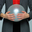 Business woman holding a balloon — Stock Photo #8432386