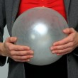 Business woman holding a balloon — Stock Photo