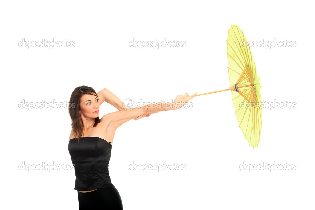 Portrait of beautiful young female with umbrella on white background  Stock Photo #8431903