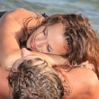 Portrait of happy couple  on the beach - Stock Photo