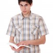 Handsome young man reading a book — Stock Photo #8443473