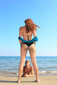 Attractive girl with boy on the beach — Stock Photo