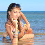 Young beautiful woman posing on the beach — Stock Photo #8459136