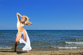 Young model on the beach — Stock Photo