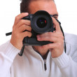 Portrait of male photographer with cameras — Stock Photo