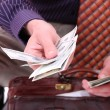 Money in a businessman hands - Foto Stock