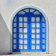 Typical blue door on the island of Santorini - Stock Photo