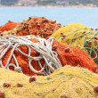 Pile yellow and orange  fishing net - Stock Photo