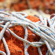 Stock Photo: Pile yellow and orange fishing net